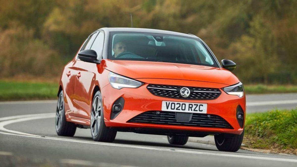 Orange Vauxhall Corsa-E driving round a bend