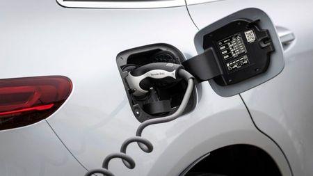 White Mercedes Benz EQC electric car charging