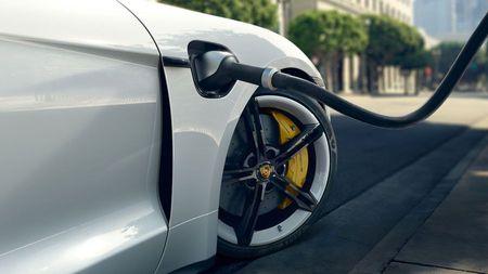 White Porsche Taycan electric car charging