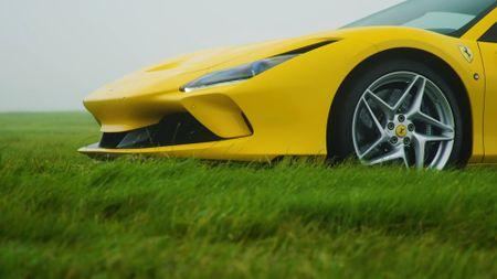 Close up of Ferrari F8 Spider wheel and bonnet