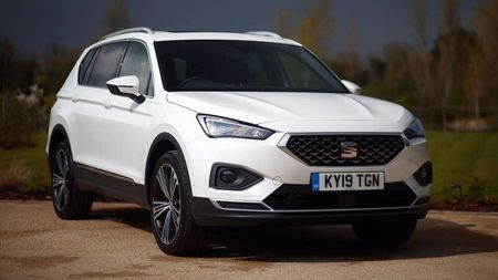 Front view of a white Seat Tarraco, a stylish family car