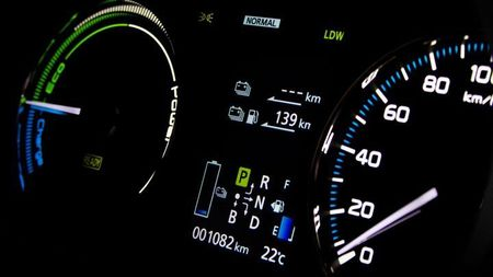 EV dashboard showing the mileage and battery capacity