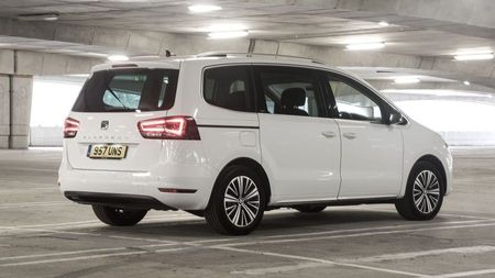 Rear view of a white Seat Alhambra in an underground carpark