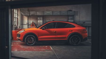 Side view of the orange Porsche Cayenne Coupe