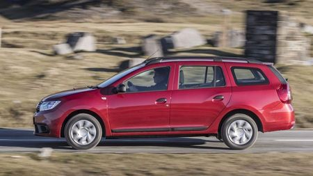Side view of a red Dacia Logan MCV, an affordable family car