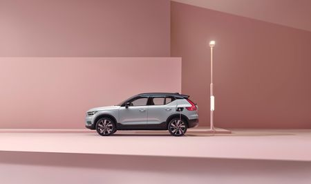 Silver Volvo XC40 electric car parked in a pink room