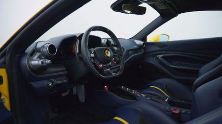 Ferrari F8 Spider cabin, with Ferrari badge on the wheel