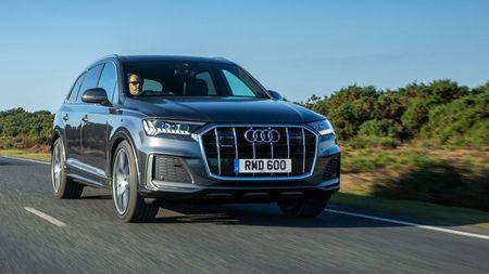 Audi Q7 driving on a tarmac road