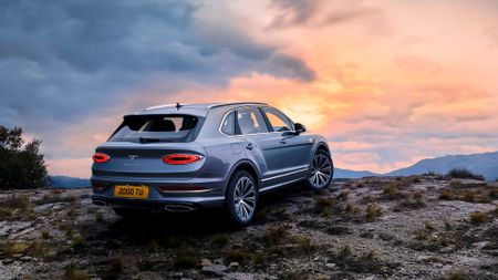 Bentley Bentayga parked in front of sunset