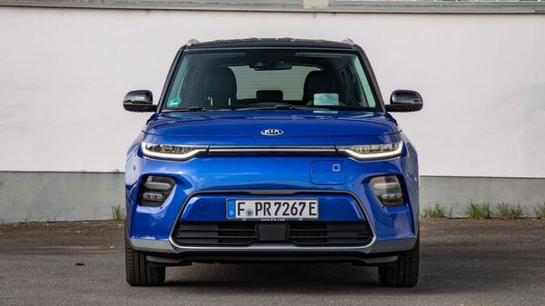 Blue Kia Soul EV parked on a drive