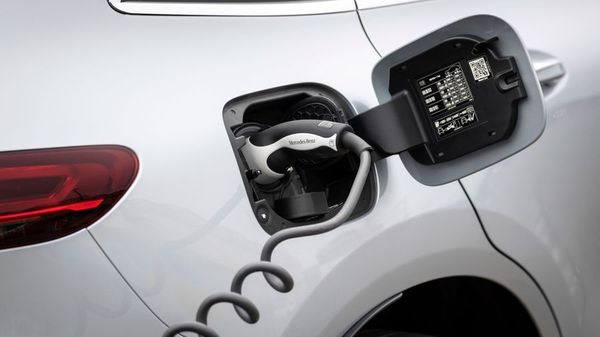 White Mercedes Benz EQC charging