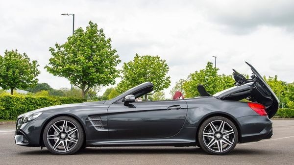Black Mercedes-Benz SL with roof down