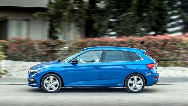Blue Skoda Scala hatchback driving down a lane