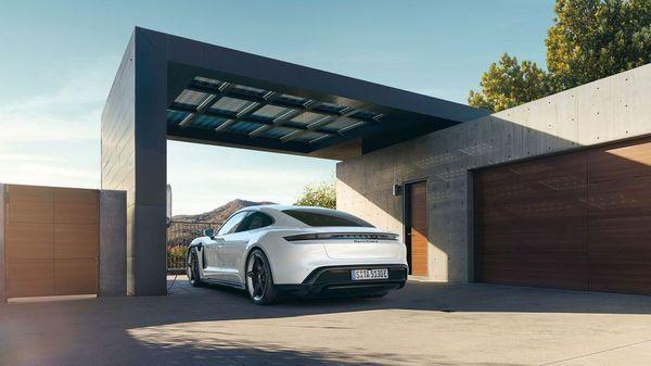 White Porsche Taycan electric car in a garage