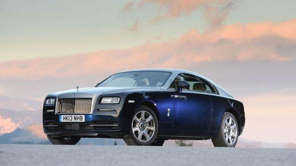 A blue Rolls-Royce Wraith on the road