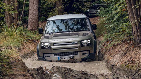 Land Rover Defender off-roading in mud
