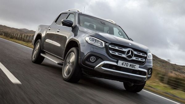 Close up of Mercedes X-Class on a stormy road
