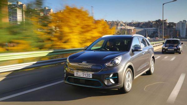 Kia e Niro electric car driving on a motorway in autumn