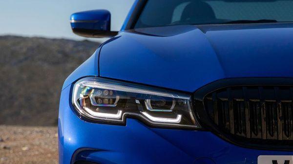 Close up of a BMW 3 Series headlamp