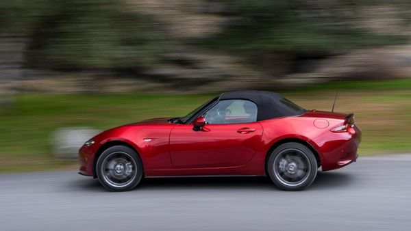 Red Mazda MX-5 on the road