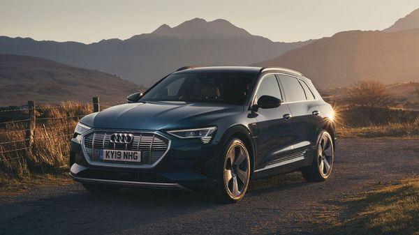 Audi E Tron electric car drives through a canyon
