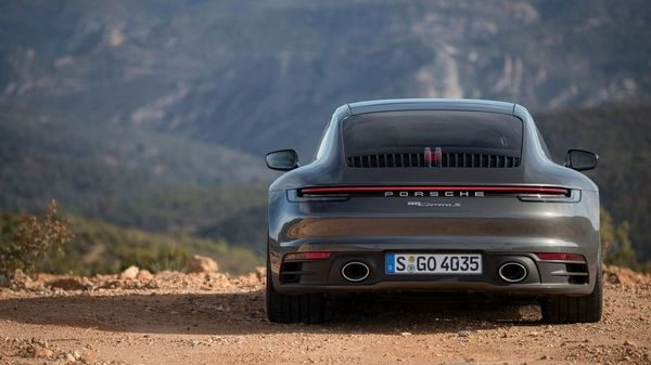 Black Porsche 911 coupe parked in the desert