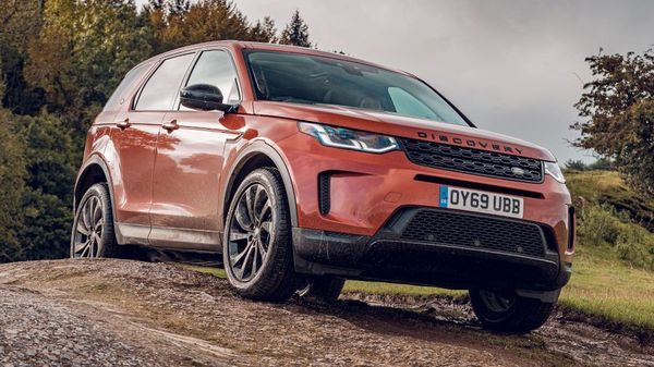 Orange Land Rover Discovery Sport parked on a track