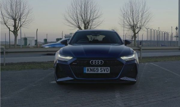Front view of a steel blue Audi RS6