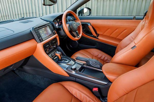 Orange and black Nissan GTR