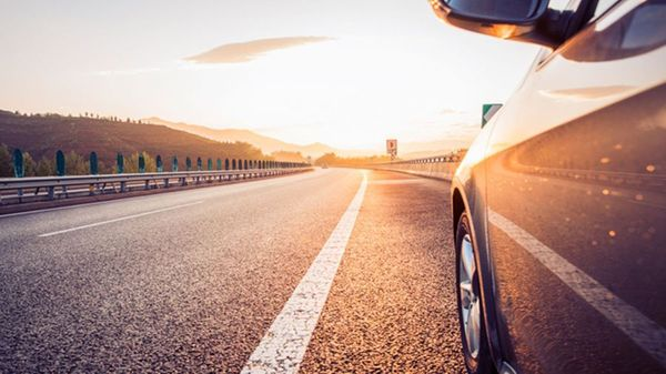 Car on a sunlit road