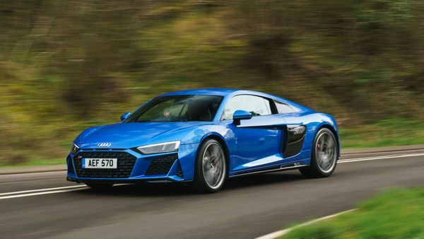 Blue Audi R8 coupe driving round a bend