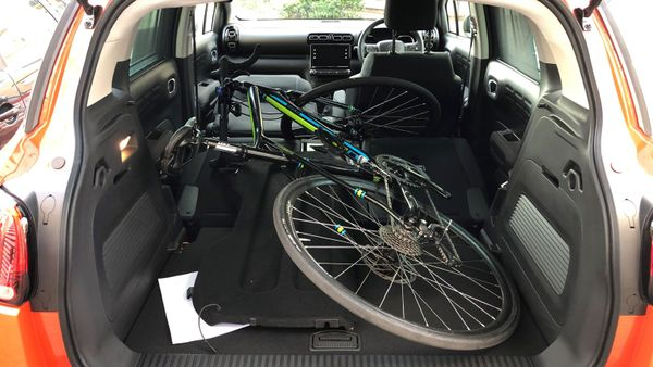 Front seat down, spare bike in