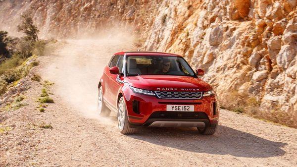Red Land Rover Range Rover Evoque driving through a canyon