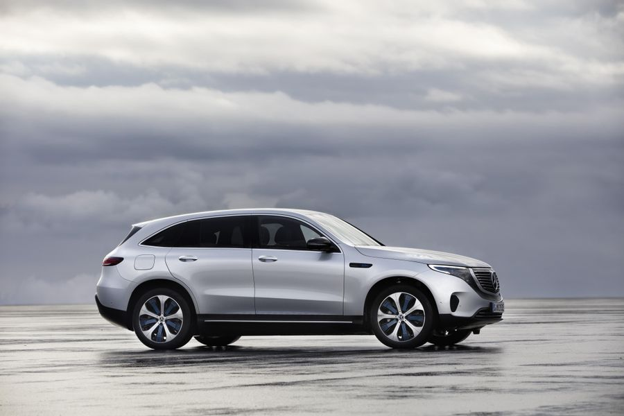 Silver driving over shallow water in a grey coastal region