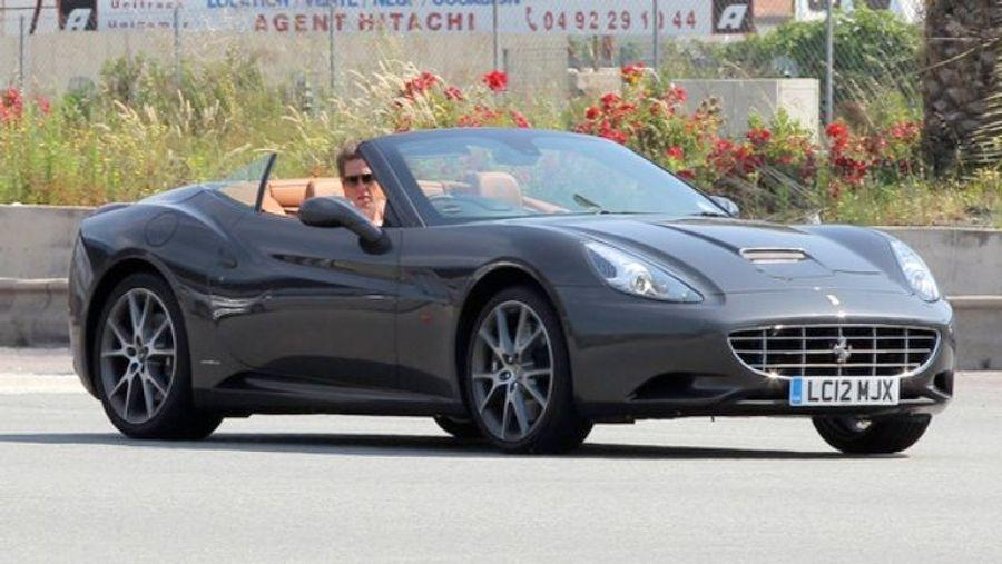 Actor Hugh Grant driving the Ferrari California