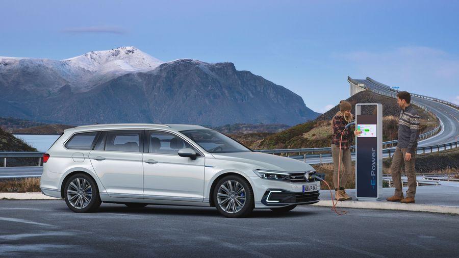 Volkswagen Passat Hybrid near a charger