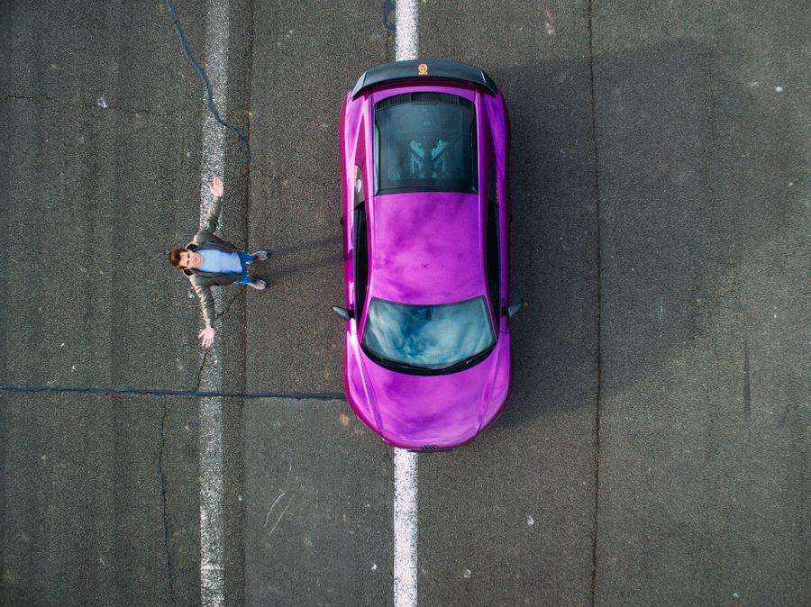 Purple car wrap on the road
