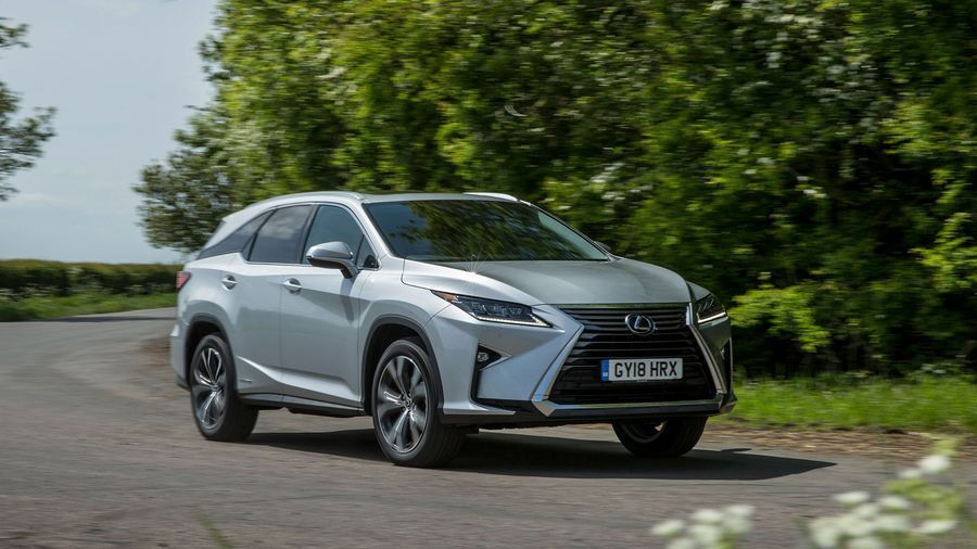 Lexus RX-L driving through a wooded area