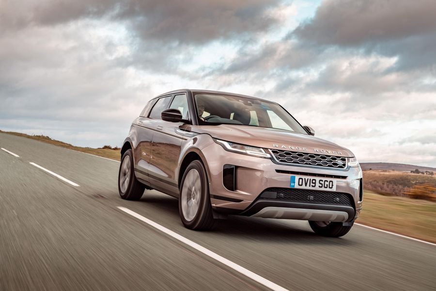 Range Rover Evoque driving over windswept hills