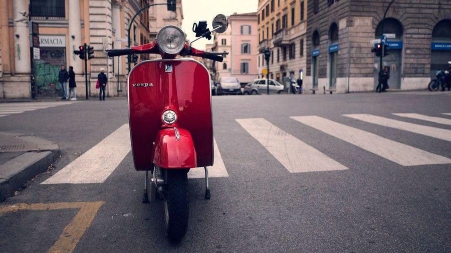 Red Vespa in Rome, Italy