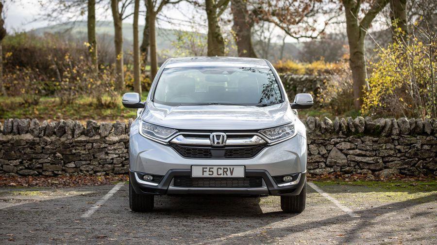 Honda CR-V Hybrid parked near a woodland