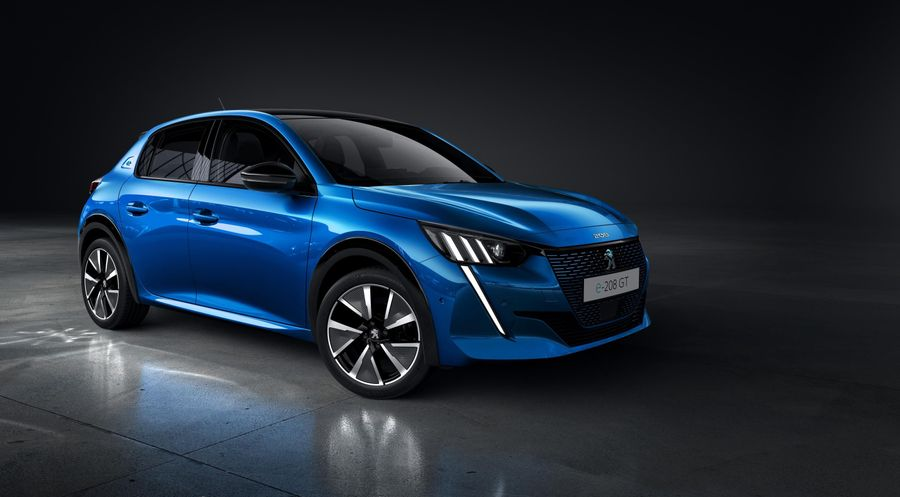 Blue Peugeot e-208 parked in a dark room