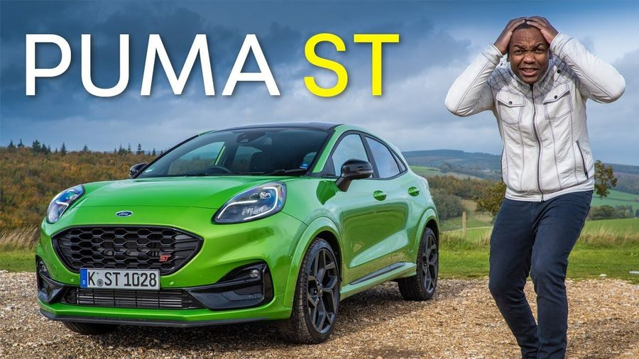 Rory Reid stands next to a green Ford Puma ST