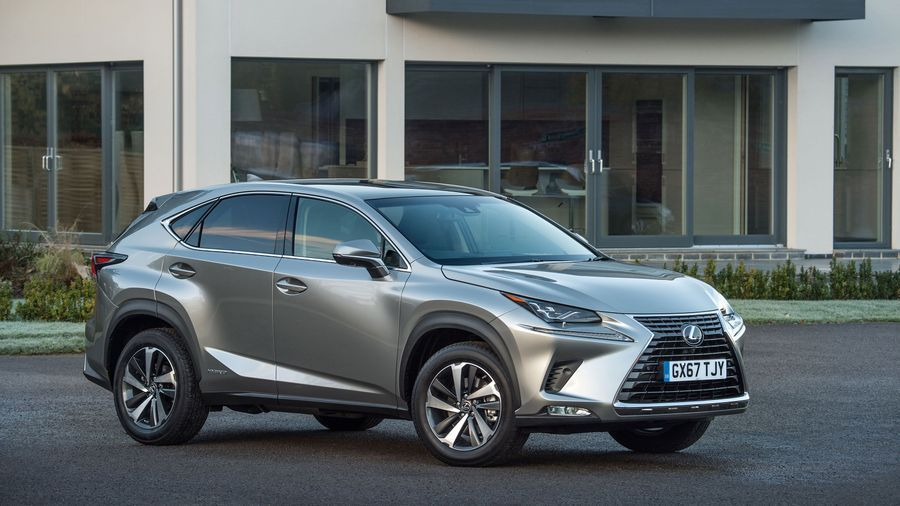 Silver Lexus NX300h hybrid parked on a drive